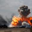 © GORAN TOMAŠEVIČ, Reuters: Automobily vojska libyjského vůdce Muammara Kaddáfího explodují po leteckém bombardování koalice mezi městy Benghází a Ajdabiyah. Libye, 20. 3. 2011 / Cars belonging to the army of Libyan leader Muammar Kaddafi explode as a result of coalition bombing between Benghazi and Ajdabiyah, Libya, 20 March 2011